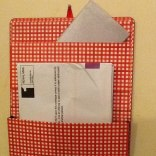 notebook upcycled into mail organiser