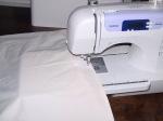 Machine stitching the seam