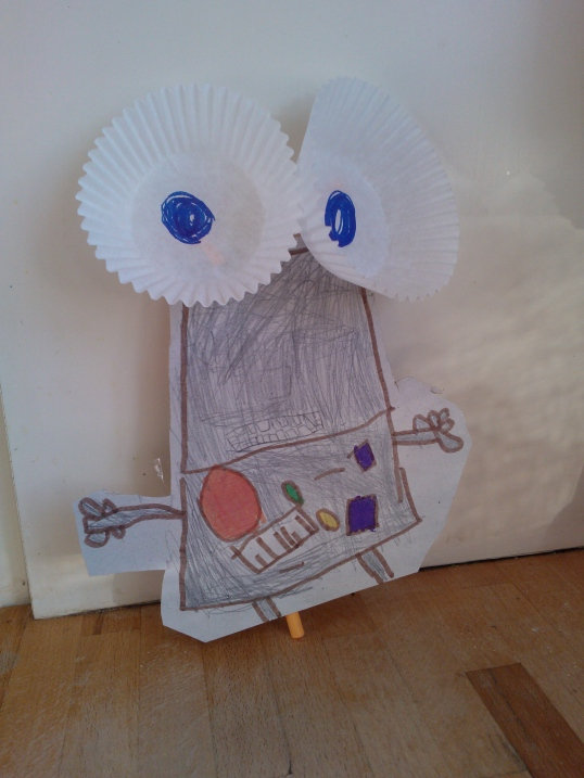 Robot with cupcake case eyes
