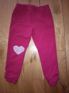 Leggings showing heart-shaped repurposed shirt patch