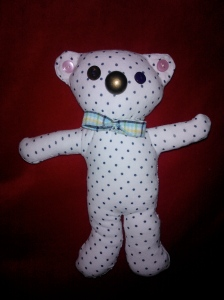 Teddy made from recycled clothes and buttons