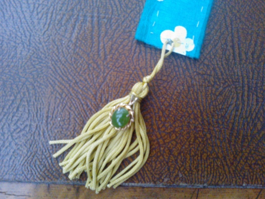 Bookmark tassle with green pendant detail