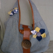 Handbag with fabric scrap brooches