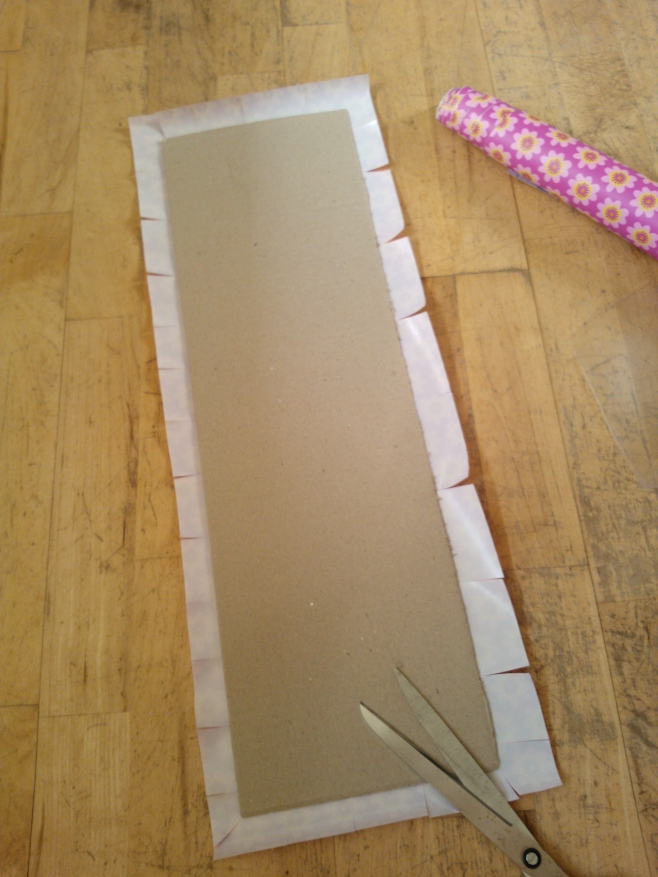 Decorating cardboard with self adhesive vinyl