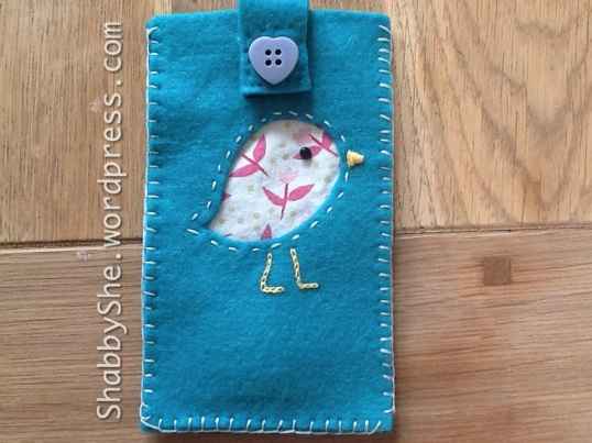 Phone case using upcycled fabric from clothes