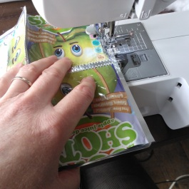 Sewing juice pouches together