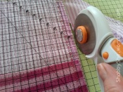 Using rotary cutter on fabric