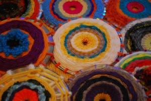Recycled CDs made into art using wool