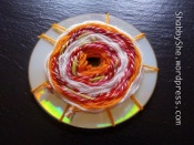 Loose weave CD loom art
