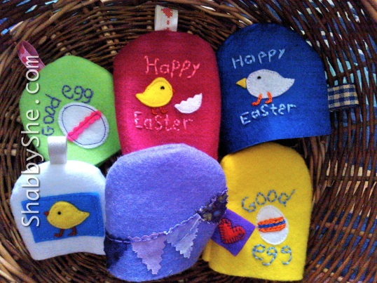 Basket of egg cosies made from felt
