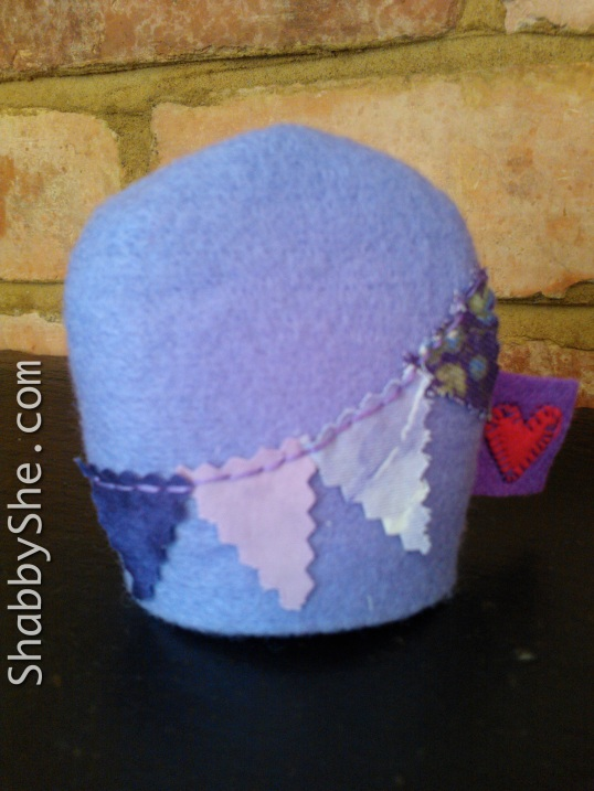 Felt egg cosy with scrap fabric bunting