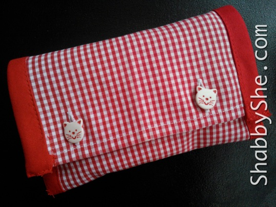 Red shirt tissue pouch with cat buttons