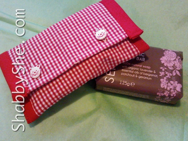 red tissue pouch made from recycled shirt cuff