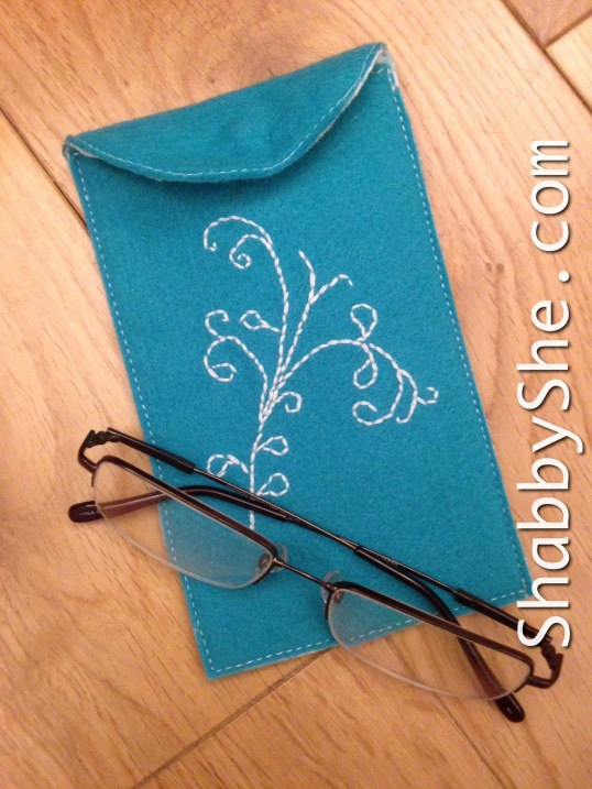 teal or turquoise glasses or phone pouch